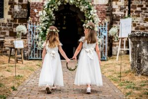 Flower girls walking into church